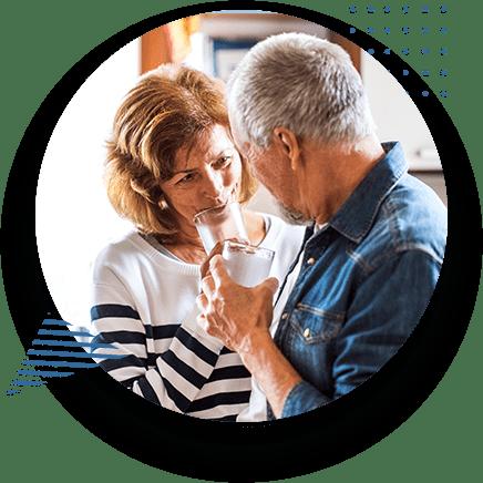 Happy Elderly Couple In Kitchen
