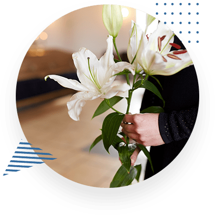 Woman Holding Flowers At Funeral